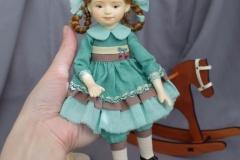 Рыжая кукла на лошадке