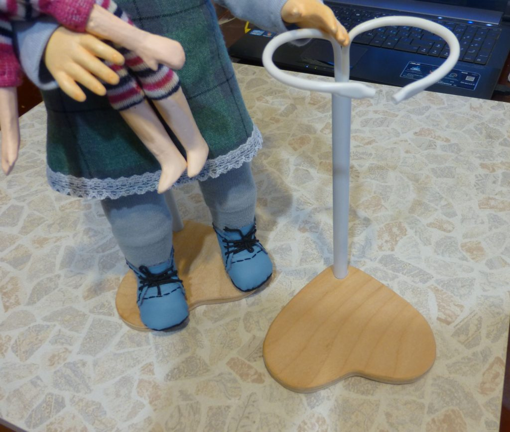 Stand-holder for the doll with his own hands